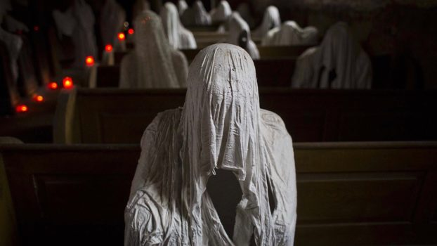 NOVEMBER 16: Ghost statues by artist Jakub Hadrava are placed at the St. George's church in Lukova, Czech Republic. (Matej Divizna/Getty Images)
